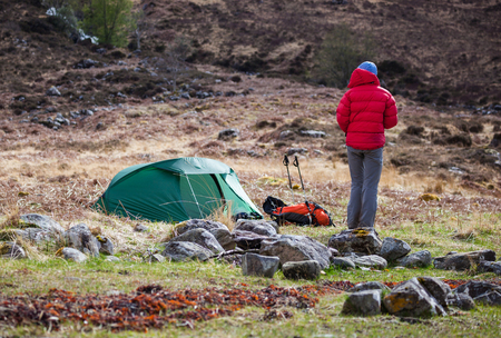 pitched: A hiker and their pitched tent at Barrisdale Bay in the Scottish Highlands. Stock Photo