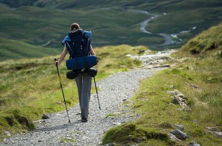 backpacking: A woman hiker backpacking in the Lake District.