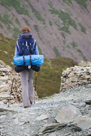 lake district: A woman hiker backpacking in the Lake District.