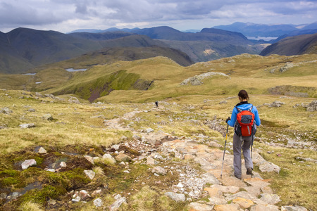 hause: Hiker returning from Scafell via Esk Hause in the Lake District. Stock Photo