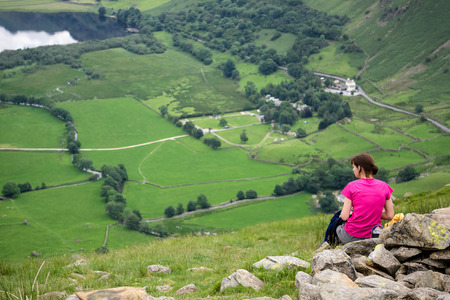cumbria: A hiker sat down above Brothers Water in the Lake District. Stock Photo