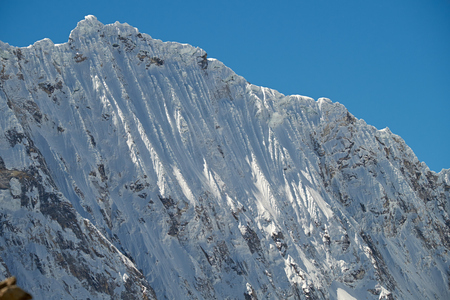 Snow fluting on the side of Ocshapalca Summit (5888m) in the Peruvian Andes.