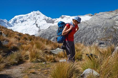 nevado: A hiker climbing up Nevado Wallunaraju (Vallunaraju) summit 5686m in the Peruvian Andes.