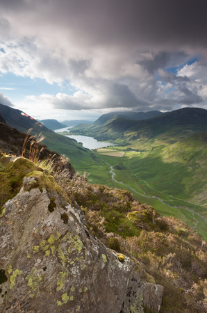 lake district: A cloudy sunset over Lake Buttermere from the summit of Haystacks in the Lake District.