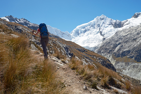 nevado: A femle hiker climbing up Nevado Ranrapalca summit in the Peruvian Andes, South America. Stock Photo