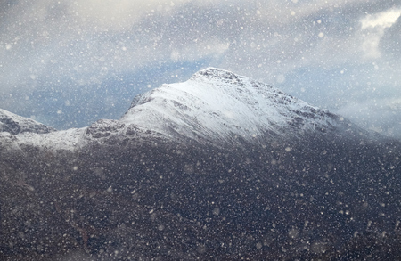 snow storm: The summit of Sgorr Ruadh near Torridon during a white out snow storm in the Scottish Highlands, UK. Stock Photo
