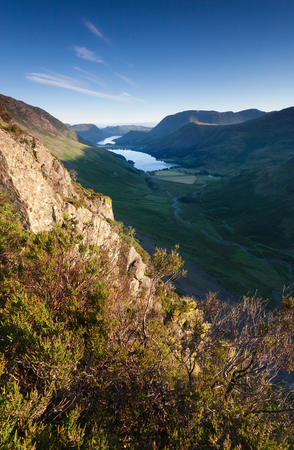 summit lake: Sunrise over Lake Buttermere from the summit of Haystacks in the Lake District. Stock Photo