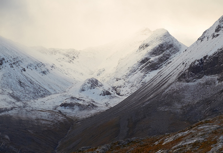 cloud capped: A cloud and snow capped summit of Beinn Eighe in the Scottish Highlands.