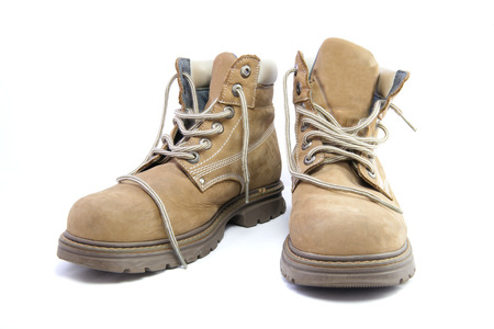 work safety: A pair of work boots isolated on a white .