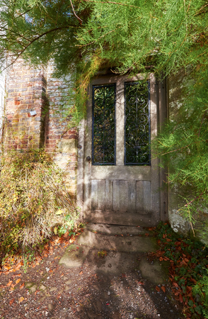 stately home: A door leading to a secret garden in an English stately home.