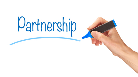 synergism: Partnership, written in marker on a clear screen.