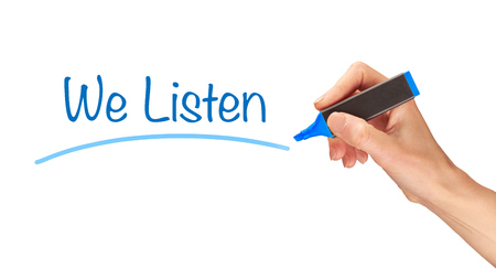 We Listen, written in marker on a clear screen.