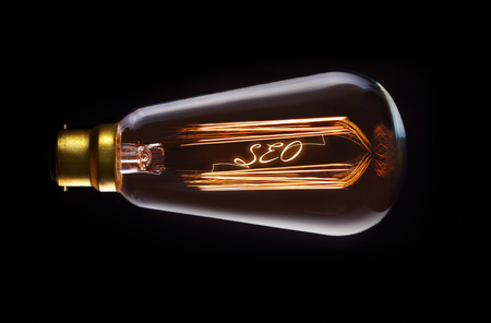 keywords link: SEO concept in a filament lightbulb.