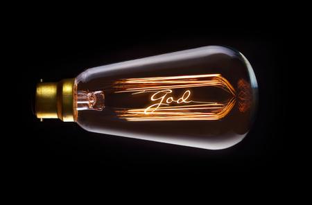 Religion, God concept in a filament lightbulb.