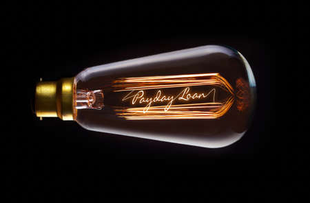 authorise: Payday Loan concept in a filament lightbulb. Stock Photo