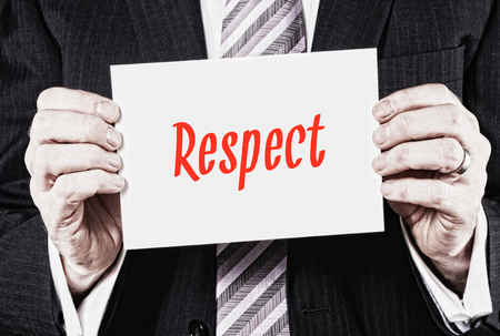 considerate: Respect, Induction Training headlines concept hold by businessman hands