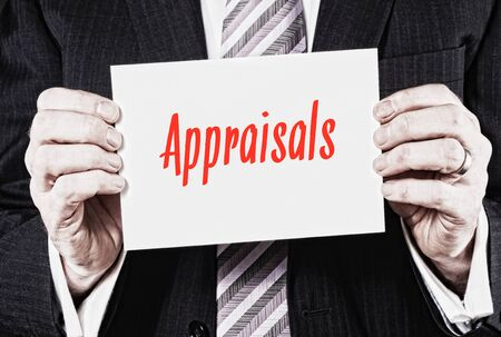 Appraisals, Induction Training headlines concept hold by businessman hands