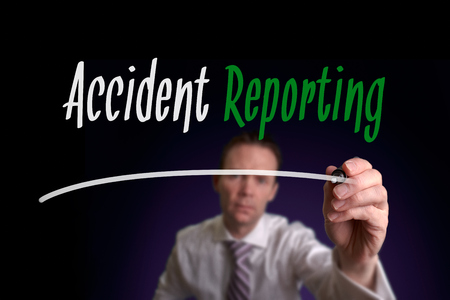 reporting: Accident Reporting, Induction Training headlines concept written by businessman hand