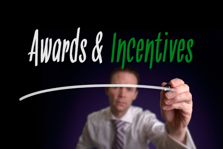 incentives: Awards & Incentives, Induction Training headlines concept written by businessman hand Stock Photo