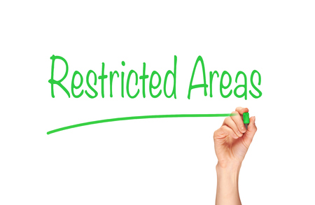 restricted: Restricted Areas written, Induction Training headlines concept.