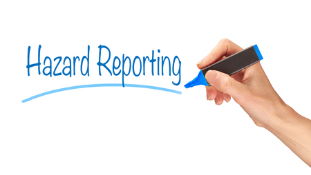 reporting: Hazard Reporting written, Induction Training headlines concept.