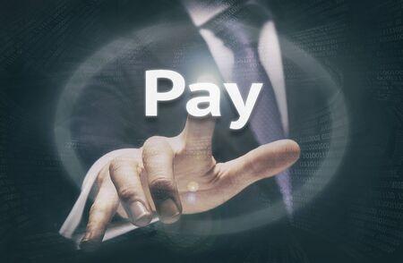 remuneraci�n: Businessman pressing a Pay concept button.