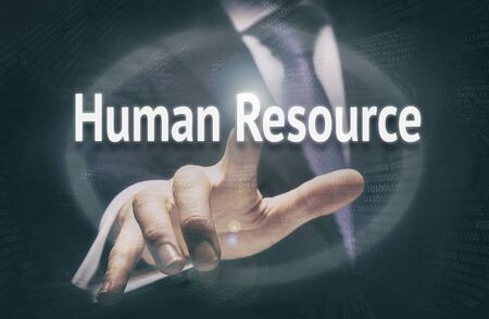 human resource management: Businessman pressing a Human Resources concept button.
