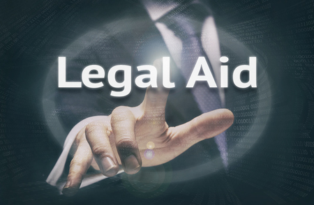Businessman pressing a Legal Aid concept button.