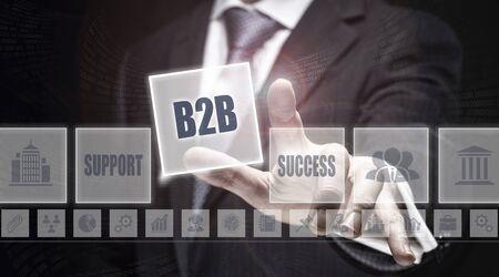 b2b: Businessman pressing a B2B concept button.