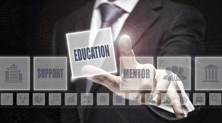 optimisation: Businessman pressing an Education concept button. Stock Photo