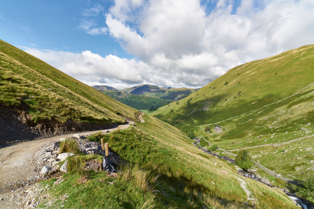 the crag: Looking down Hayeswater Gill towards Hartsop with Prison Crag to the right in the English Lake District, UK. Stock Photo