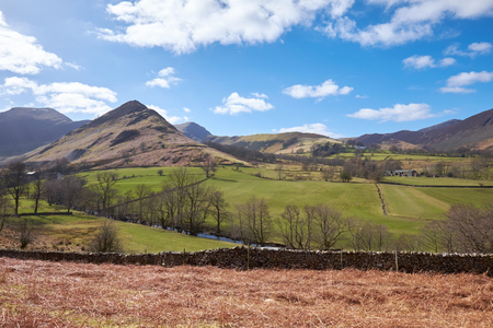 Newlands Beck with High Crags, Scope End and Low Snab in the English Lake District, UK. Stock Photo