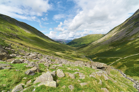 beck: Pasture Beck with Hartsop and Brock Crags in the distance in the English Lake District, UK. Stock Photo