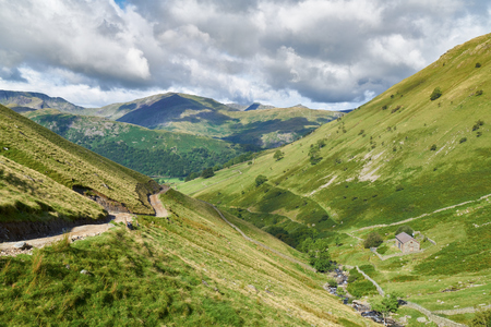 crag: Looking down Hayeswater Gill towards Hartsop with Prison Crag to the right in the English Lake District, UK. Stock Photo