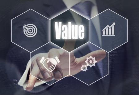 strategic advantage: Businessman pressing a Value concept button.