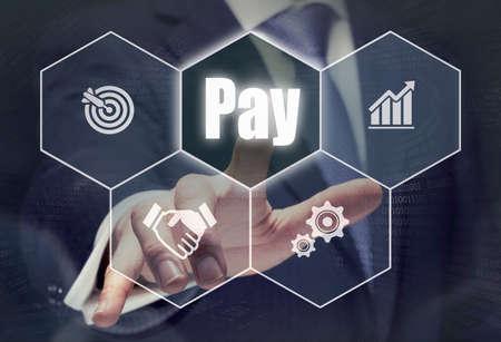 remuneration: Businessman pressing a Pay concept button.