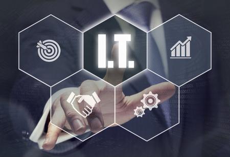 Businessman pressing an I.T. concept button.