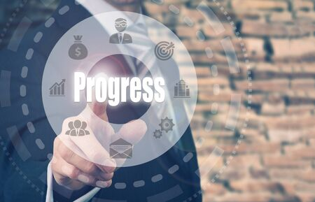 target thinking: Businessman pressing an Progress concept button. Stock Photo