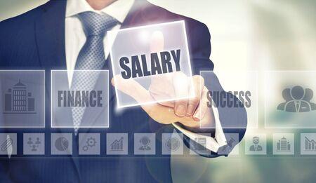 remuneration: Businessman pressing an Salary concept button.