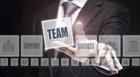 synergism: Businessman pressing an Team concept button. Stock Photo