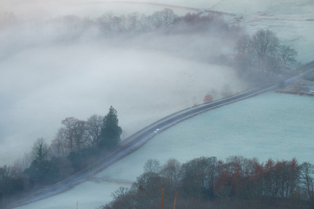 driving conditions: A car driving along an icy road in the English countryside, Lake District UK. Stock Photo