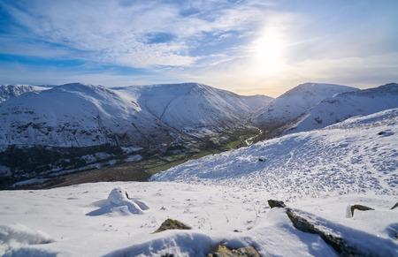 gill: Views of snow covered Angletarn, Hayeswater Gill, Gray Crag & Hartsop Dodd from Hartsop Above How. English Lake District. Stock Photo