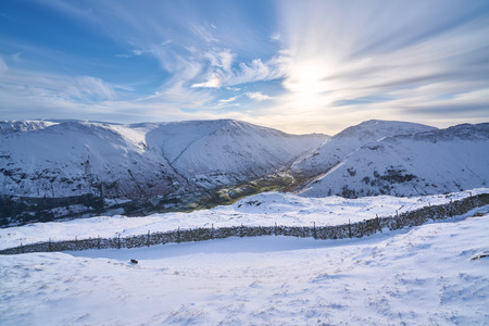 crag: Views of snow covered Angletarn, Hayeswater Gill, Gray Crag & Hartsop Dodd from Hartsop Above How. English Lake District. Stock Photo