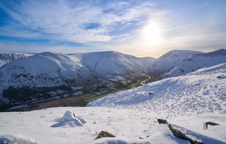 the crag: Views of snow covered Angletarn, Hayeswater Gill, Gray Crag & Hartsop Dodd from Hartsop Above How. English Lake District. Stock Photo