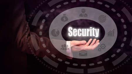 authorisation: Businessman pressing an Security concept button. Stock Photo