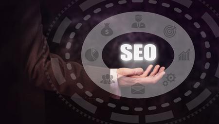 meta data: Businessman pressing an SEO concept button.