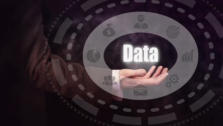 lockout: Businessman pressing a Data concept button.