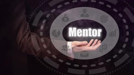 mentors: Businessman pressing a Mentor concept button.