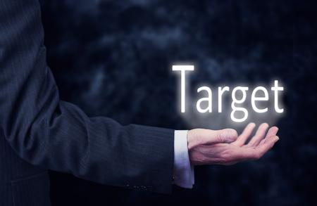 focalise: Businessman pressing an Target concept button.
