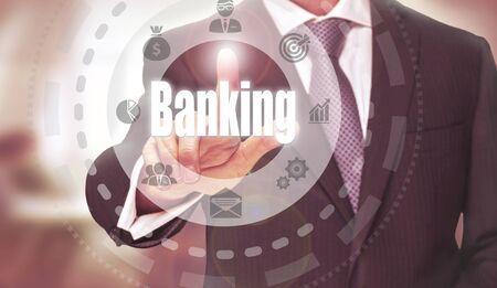 banking concept: Businessman pressing an Banking concept button.